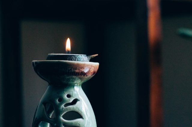 rule of thirds photography of lit candle